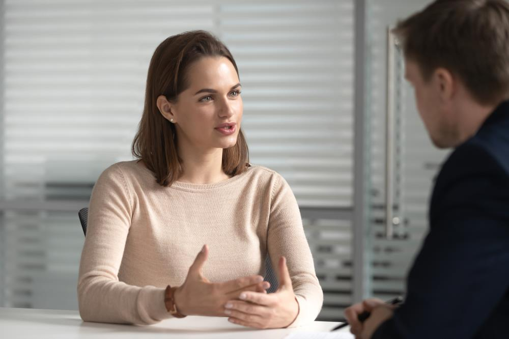 Employee speaking with her boss during meeting
