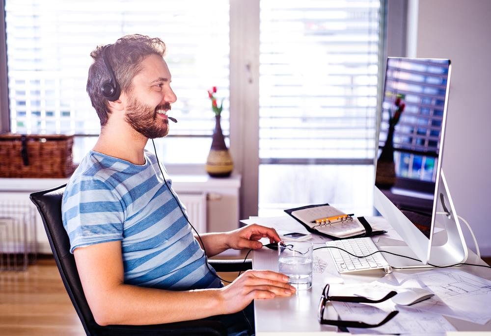 remote employee on the phone with his manager in his home office