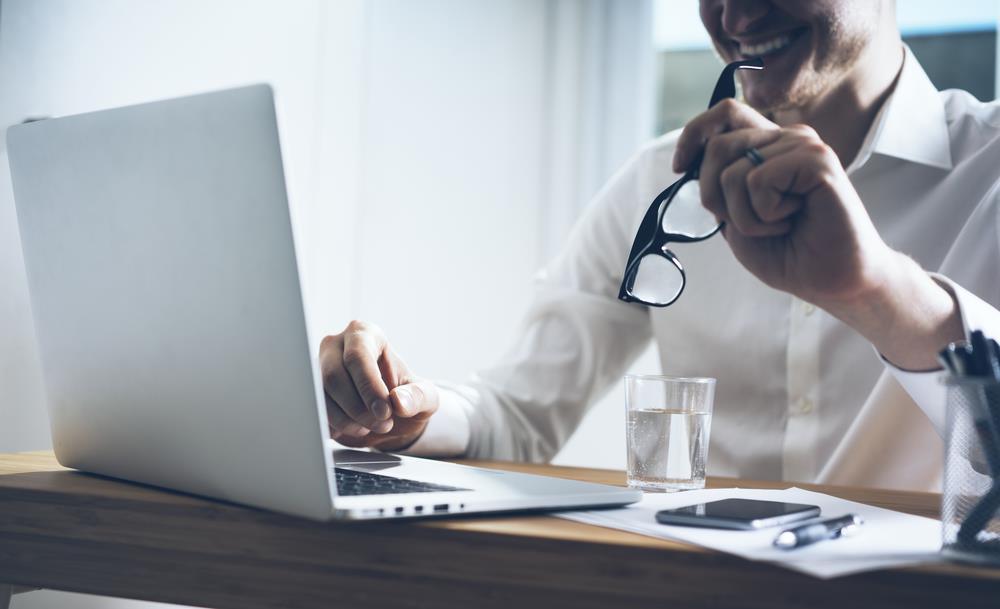 Job seeker working to create a value-based resume.