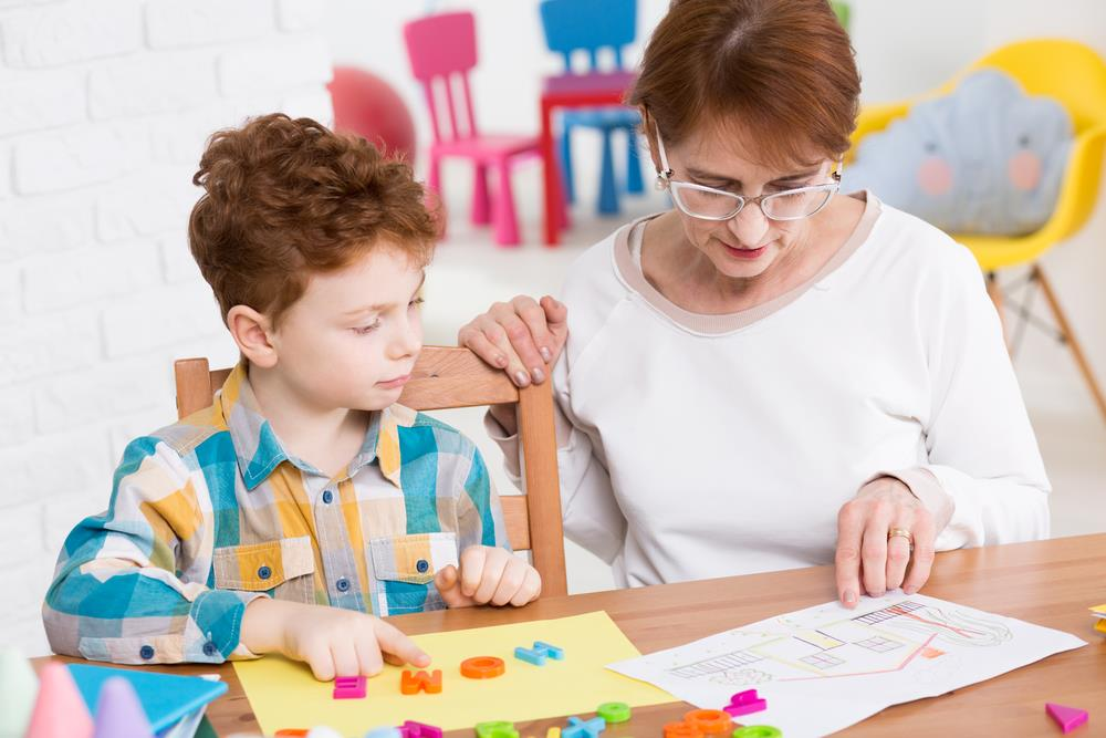 Occupational therapist meeting with young boy