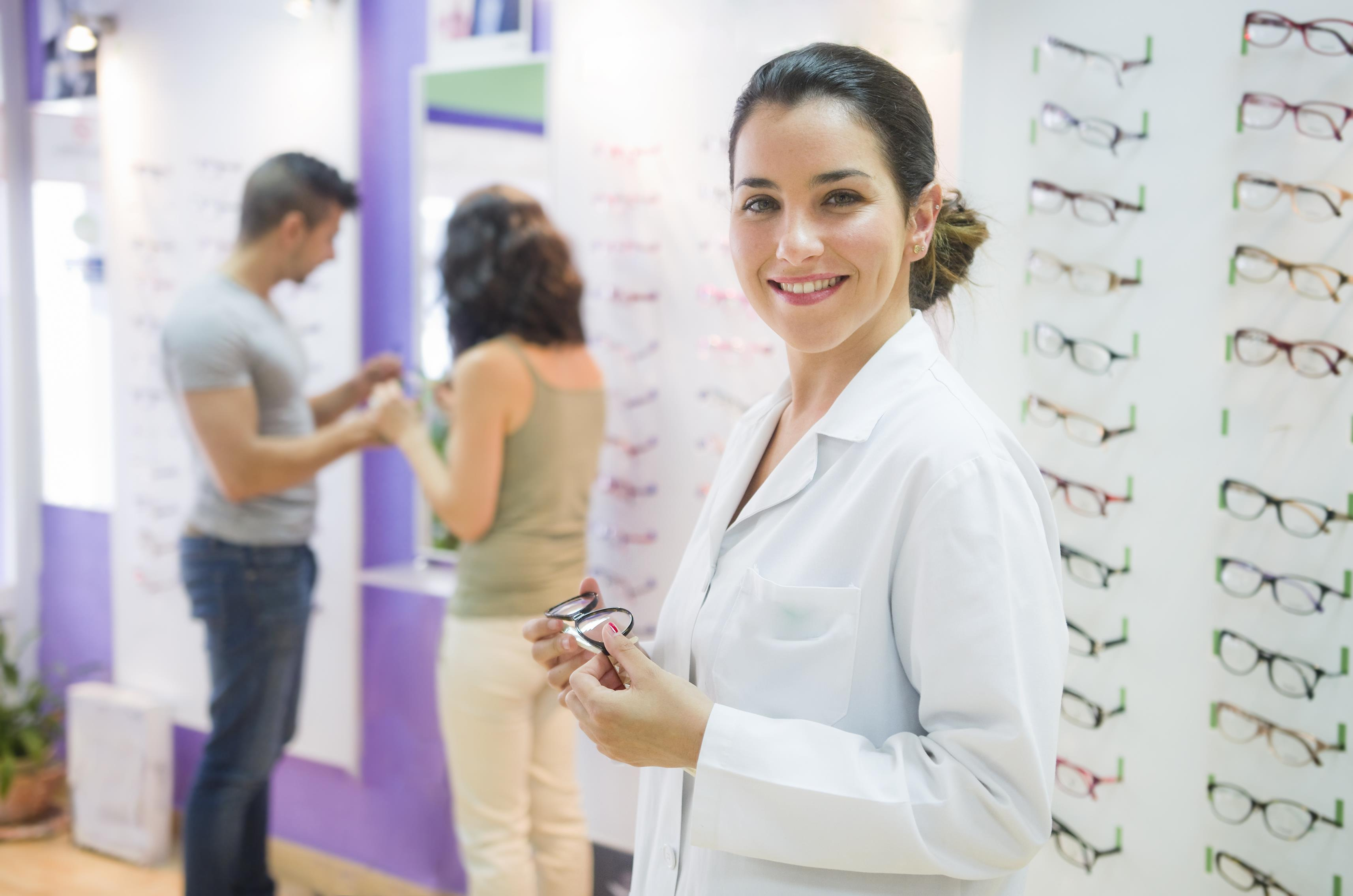 optometrist helping patients select eye glasses on the retail floor