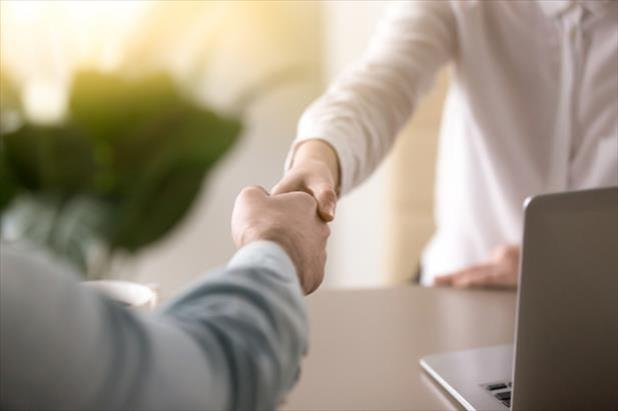 Hiring manager shaking hands with job applicant