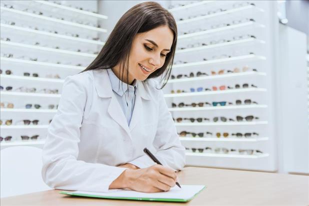 Optician working on paperwork
