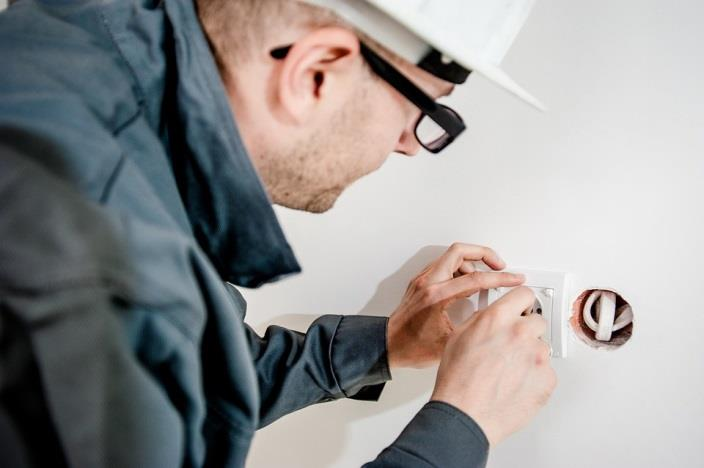 Electrician installing wiring in a home