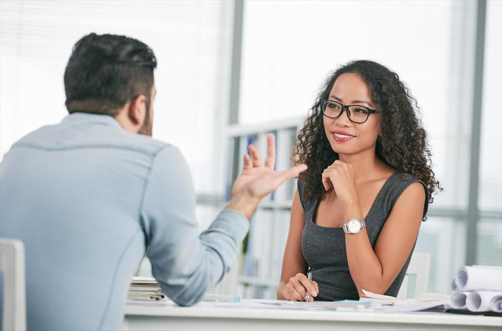 Young woman in job interview with a hiring manager