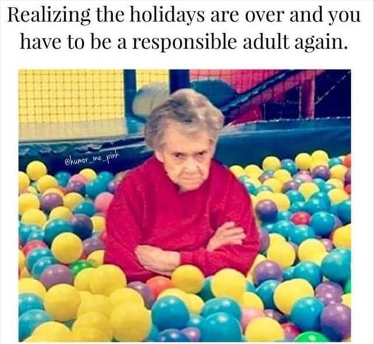 Old woman in ball pit frowning and crossing her arms