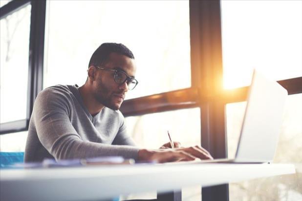 Freelance professional working on laptop