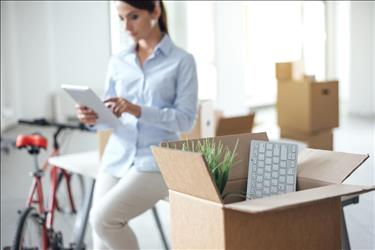 woman packing up her office to relocate to a new city