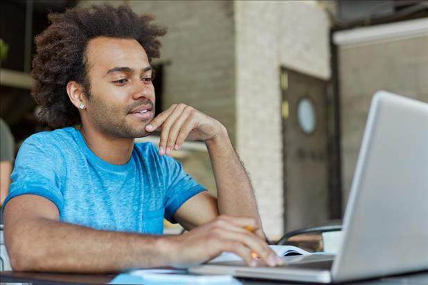 male marketing professional taking an online course on his laptop