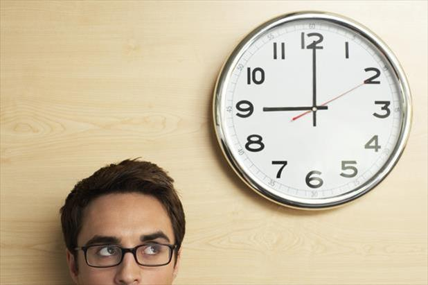 Job seeker looking at clock and thinking about what they can get done in an hour
