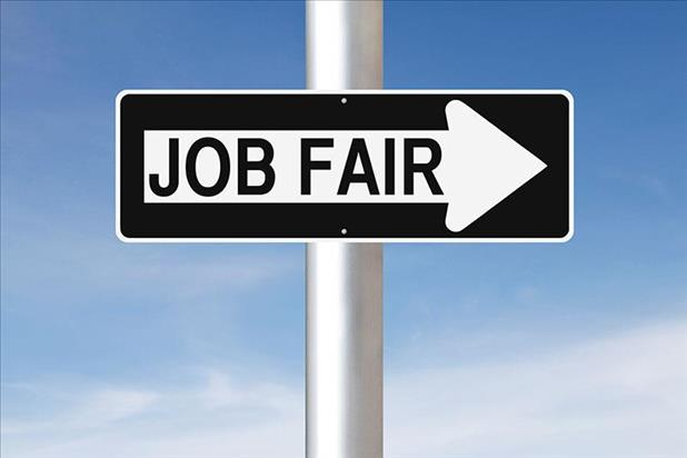 Sign directing job seekers to a job fair