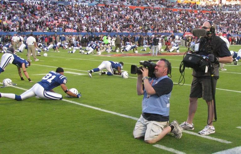 sports camera operator on knees